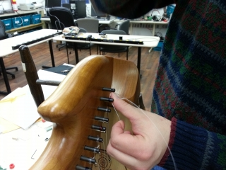 Installing the last harp string